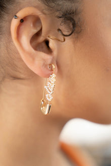 golden statement clip earrings