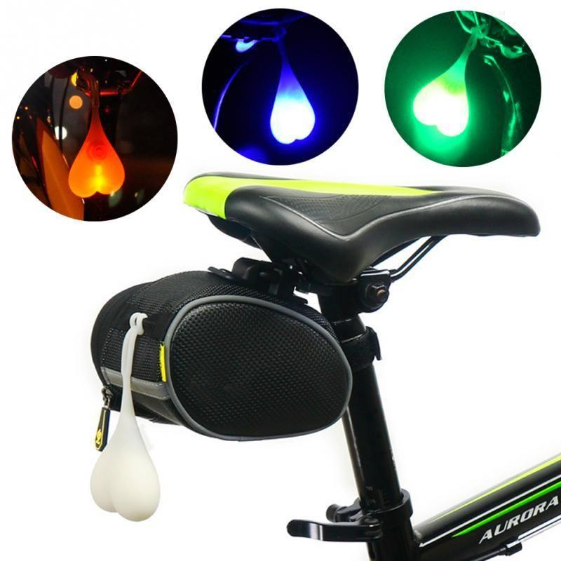 Image of glowing bike balls hanging to the bike - all