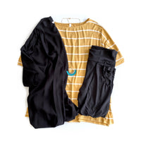 Honey colored, relaxed fit striped top for casual wear. Shown with black kimono and black capri leggings.