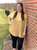 Honey colored, relaxed fit striped top for casual wear on plus sized model.