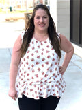 Dainty floral print tank top with ruffle bottom on plus sized model.