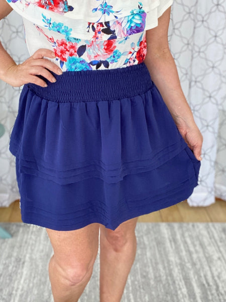 Flirty navy skirt with a comfortable smocked waistband.