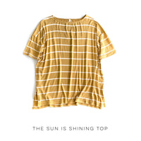Honey colored, relaxed fit striped top for casual wear on a white background.