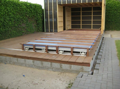 The decking is fitted to the top of the cover
