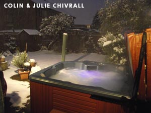 Colin & Julie Chivralls hottub standing in their garden with snow around