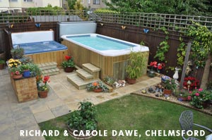 Family Dawes Swim Spa standing next to their whirlpool in their beautiful garden full with plants