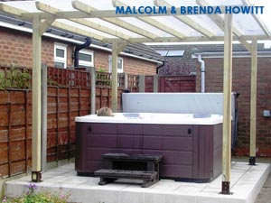 Malcom & Brenda Howitts hottub, roofed with stairs