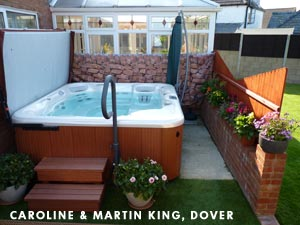 Caroline & Martin Kings hottub standing in theit garden, filled with water and the cover open