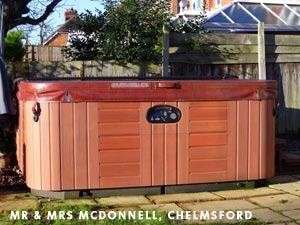 Mr & Mrs McDonnels hottub standing in their garden with the cover closed