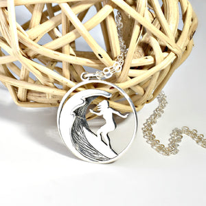 Sterling silver surfer girl charm necklace.