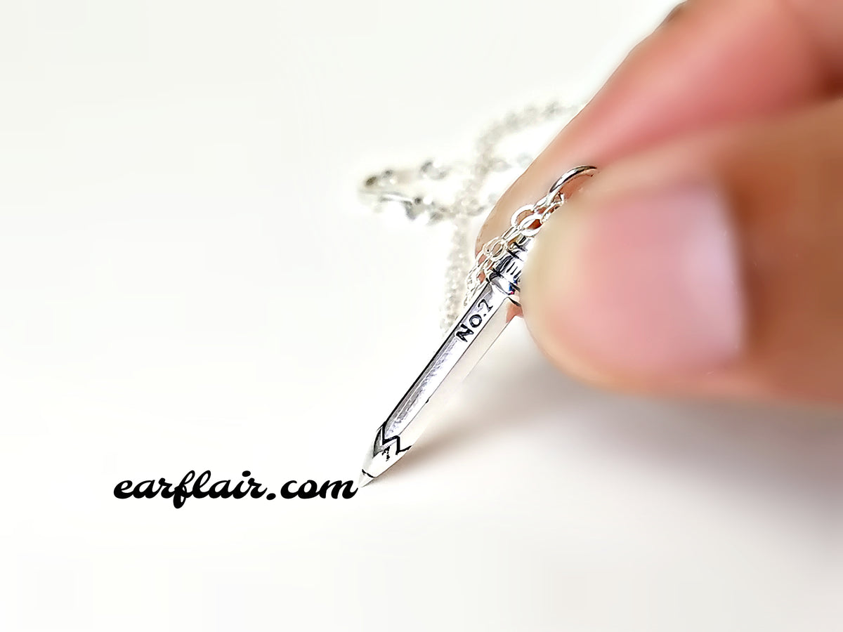 Sterling silver pencil charm necklace.