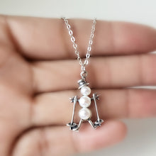 Load image into Gallery viewer, Silver and Pearls Skiing Snowman Charm Necklace -- EF0084