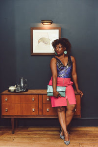 Model with Glitter Disco Envelope Clutch Bag in Aqua