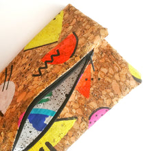 Load image into Gallery viewer, Hand Painted Cork Purses in 80's geometric pattern open with 80's print lining