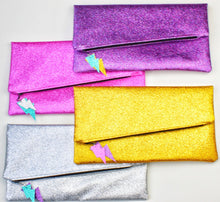 Load image into Gallery viewer, Glitter Disco Envelope Clutch Bags with Lightning Bolt Tags. Pink, purple, silver, gold