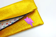 Load image into Gallery viewer, Glitter Disco Envelope Clutch Bags with Gold Glitter Fabric Open with spotty lining and lightning bolt tags