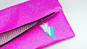 Glitter Disco Envelope Clutch Bags with Pink Glitter Fabric Open with stripey lining and lightning bolt tags