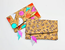 Load image into Gallery viewer, Hand Painted Cork Purses in 80's geometric pattern or leopard print with lightning bolt tag