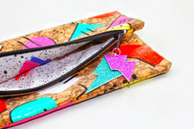 Load image into Gallery viewer, Hand Painted Cork Purses in 80's geometric pattern open with 80's print lining and lightning bolt tag