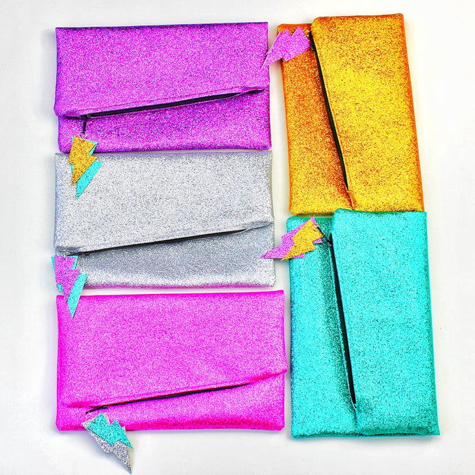 Glitter Disco Envelope Clutch Purses with Lightning Bolt Tags. Pink, purple, silver, gold and Aqua