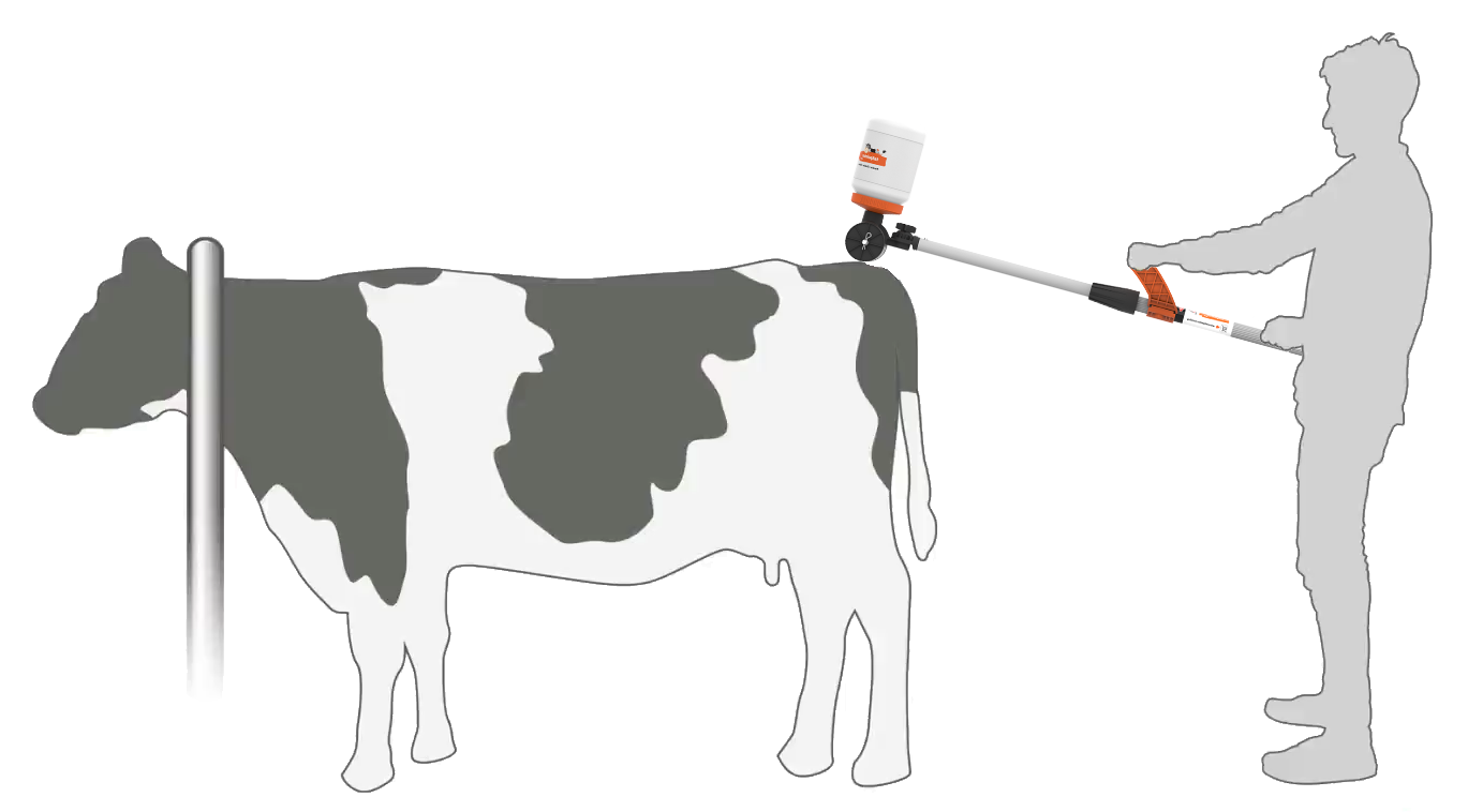 silhouette of a farmer using the Tailpainter in the feed barrier mode