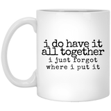have it all together black Mugs