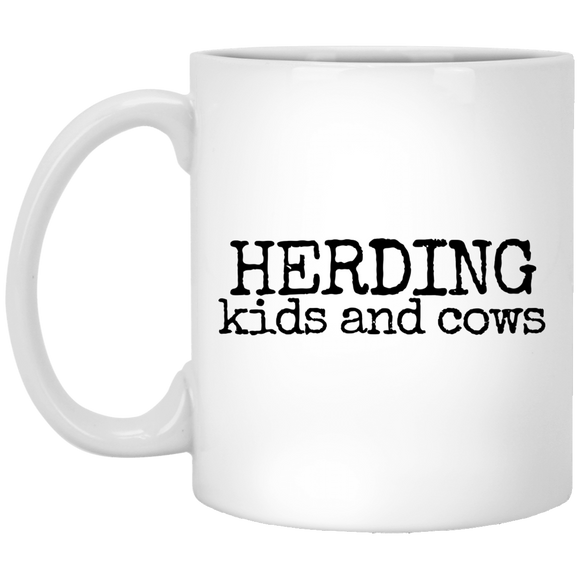 herding kids and cows black Mugs