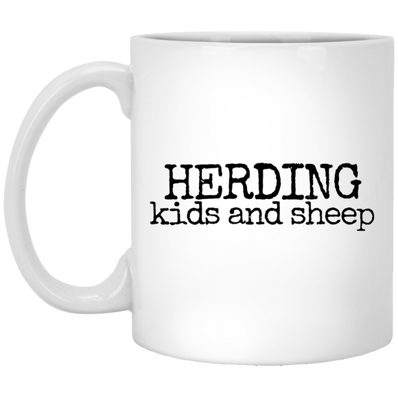 herding kids and sheep black Mugs