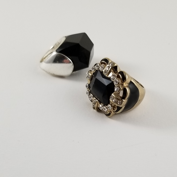 Ring 1 is black stone in a light weight setting.  Ring 2 Black and Rhinestone Rings. The Center if facetted