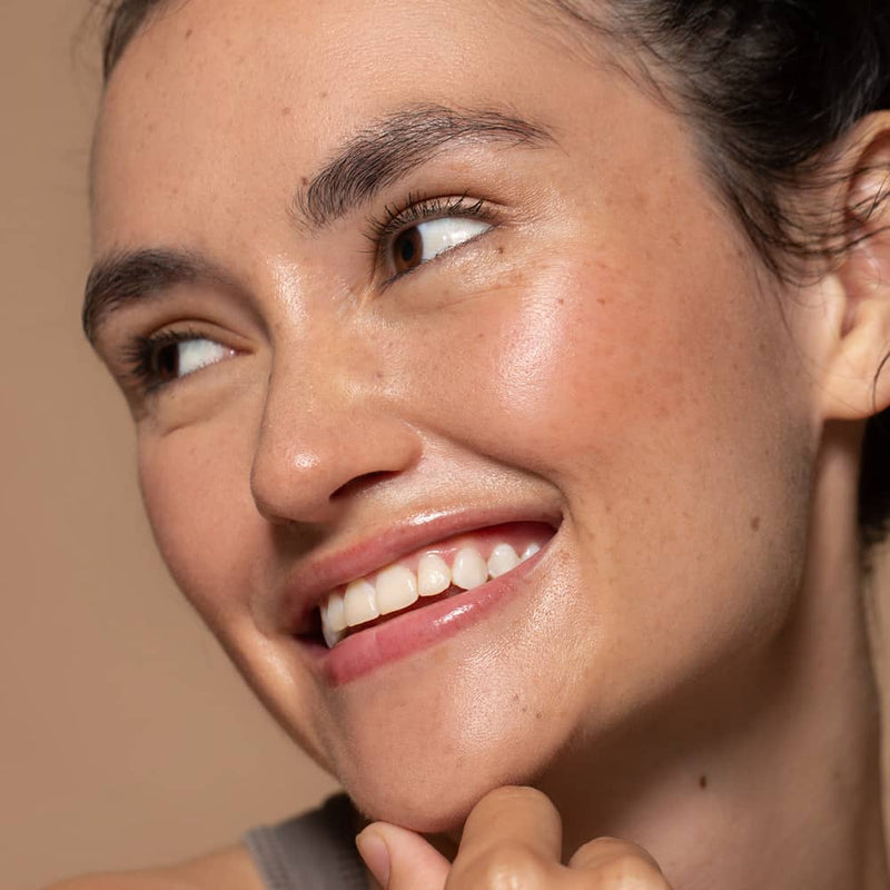 Happy Six Gldn model with a smile and fresh clean glowing radiant skin