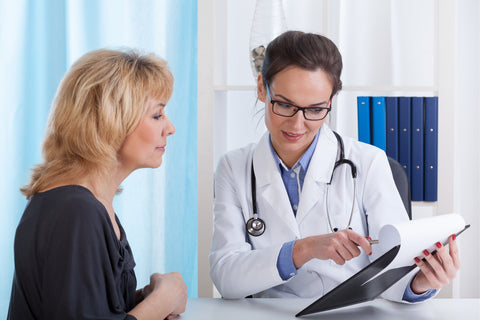 Woman discussing sleep apnea with her doctor