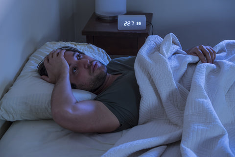 man in bed not able to sleep due to shortness of breath