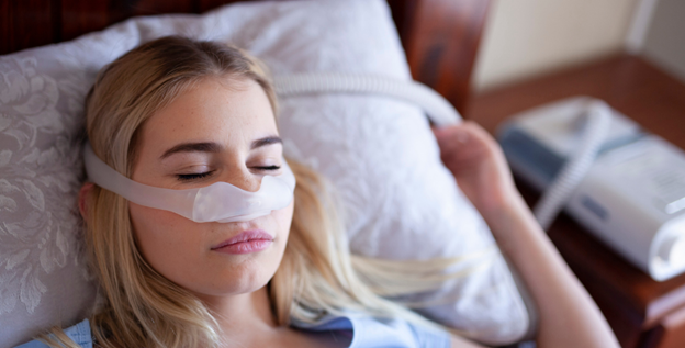 Woman sleeping while using CPAP Mask