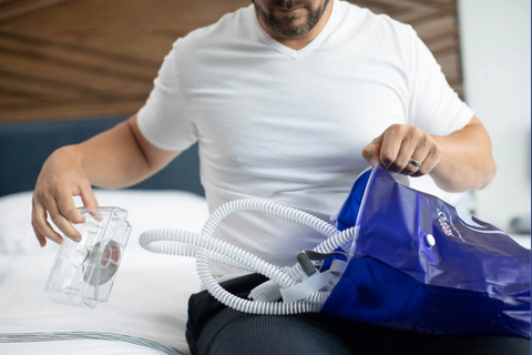 A man putting away his CPAP cleaning devices