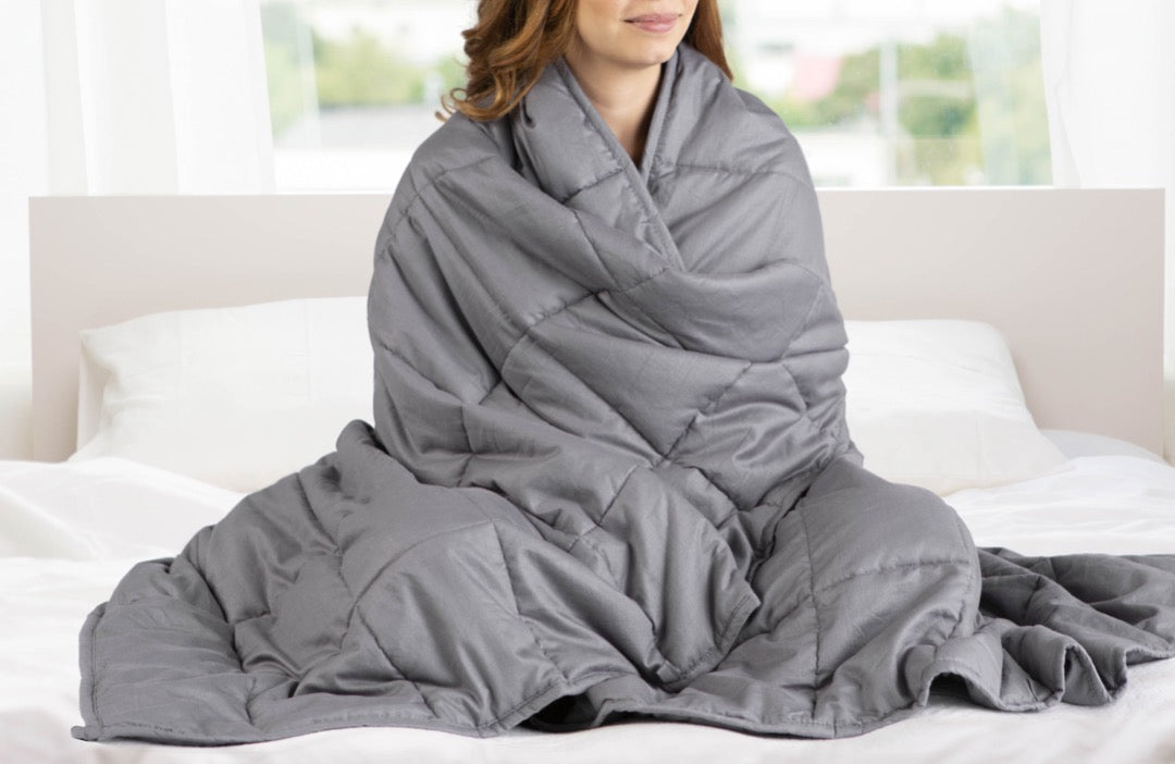 "Woman hugging 41"" x 60"" Weighted Blanket Grey"