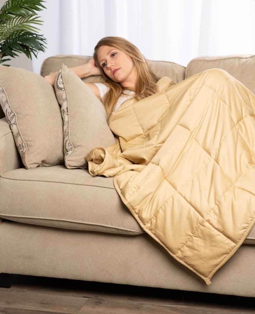 "Woman using 41"" x 60"" Weighted Blanket Taupe"