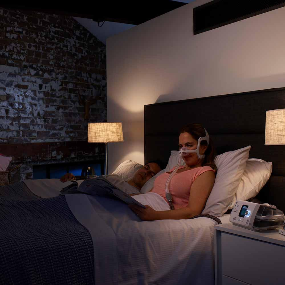 Airsense 10 for her on nightstand next to lady.