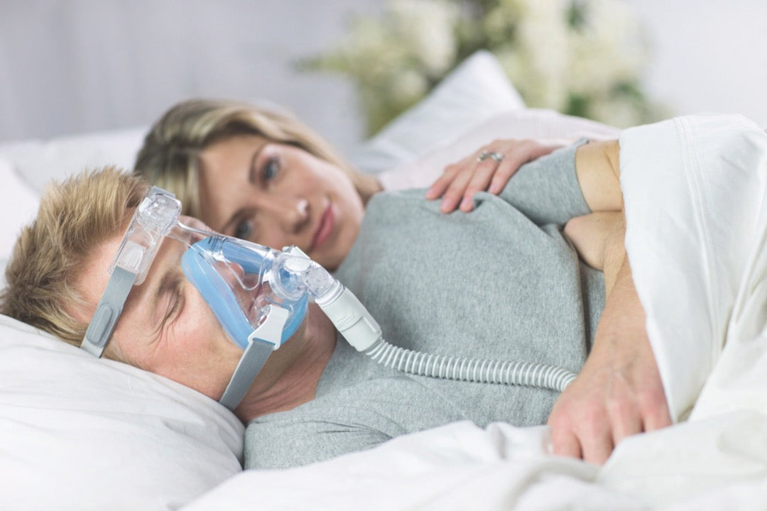 Couple sleeping with man using Amara Full Face CPAP Mask with Gel & Silicone Cushions