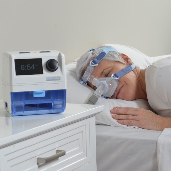 Woman sleeping using IntelliPAP 2 AutoAdjust Auto-CPAP Machine Package with Heated Humidifier