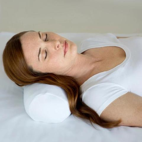 Woman sleeping with Comfort Bolster White Pillow under her neck.