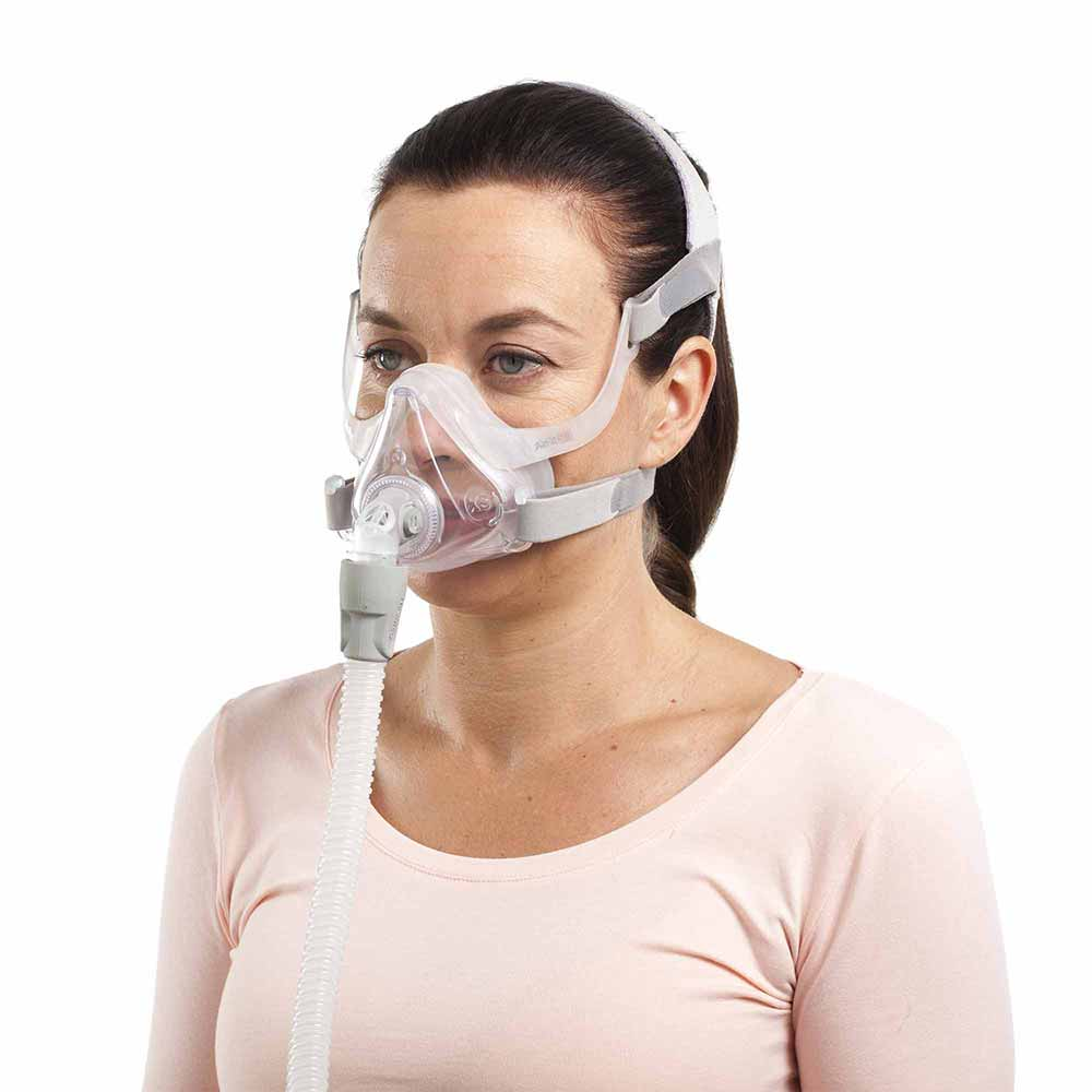 Woman using ResMed AirFit F10 Mask.