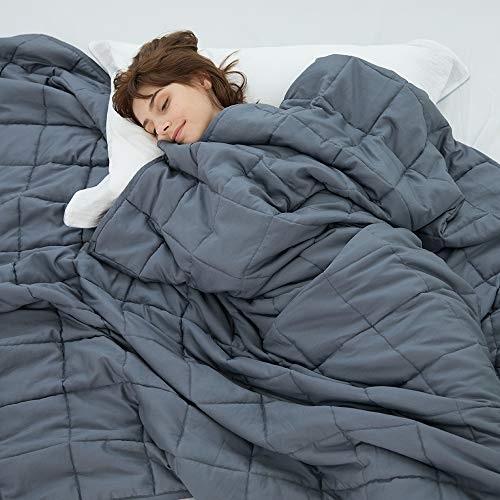 Woman sleeping in weighted blanket.
