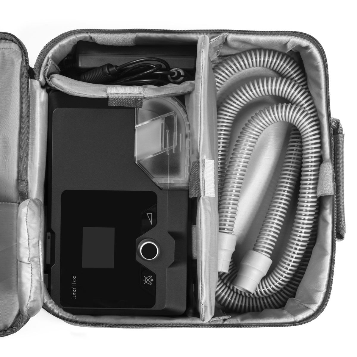 Top view of carrying case with Luna II QX Auto CPAP Machine, swivel tube connector and battery adapter.