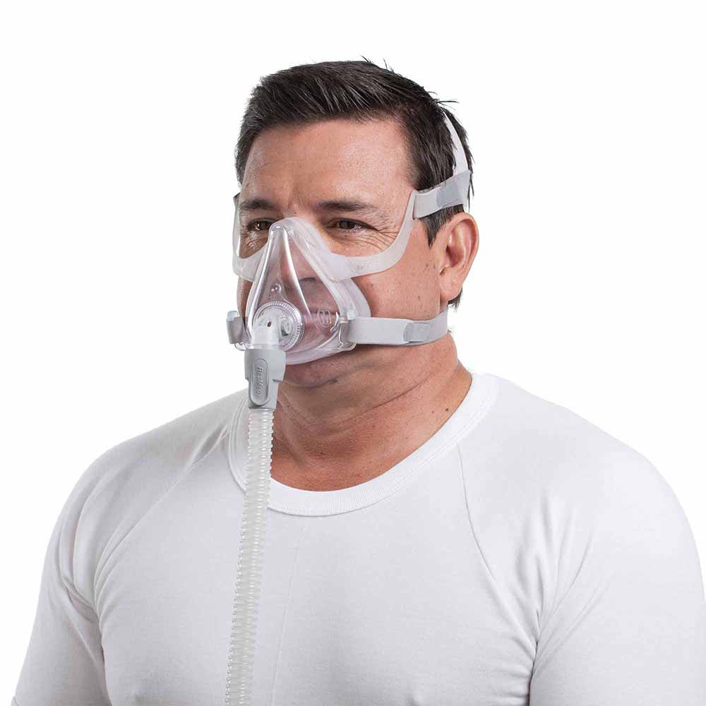 Man using ResMed AirFit F10 Mask.