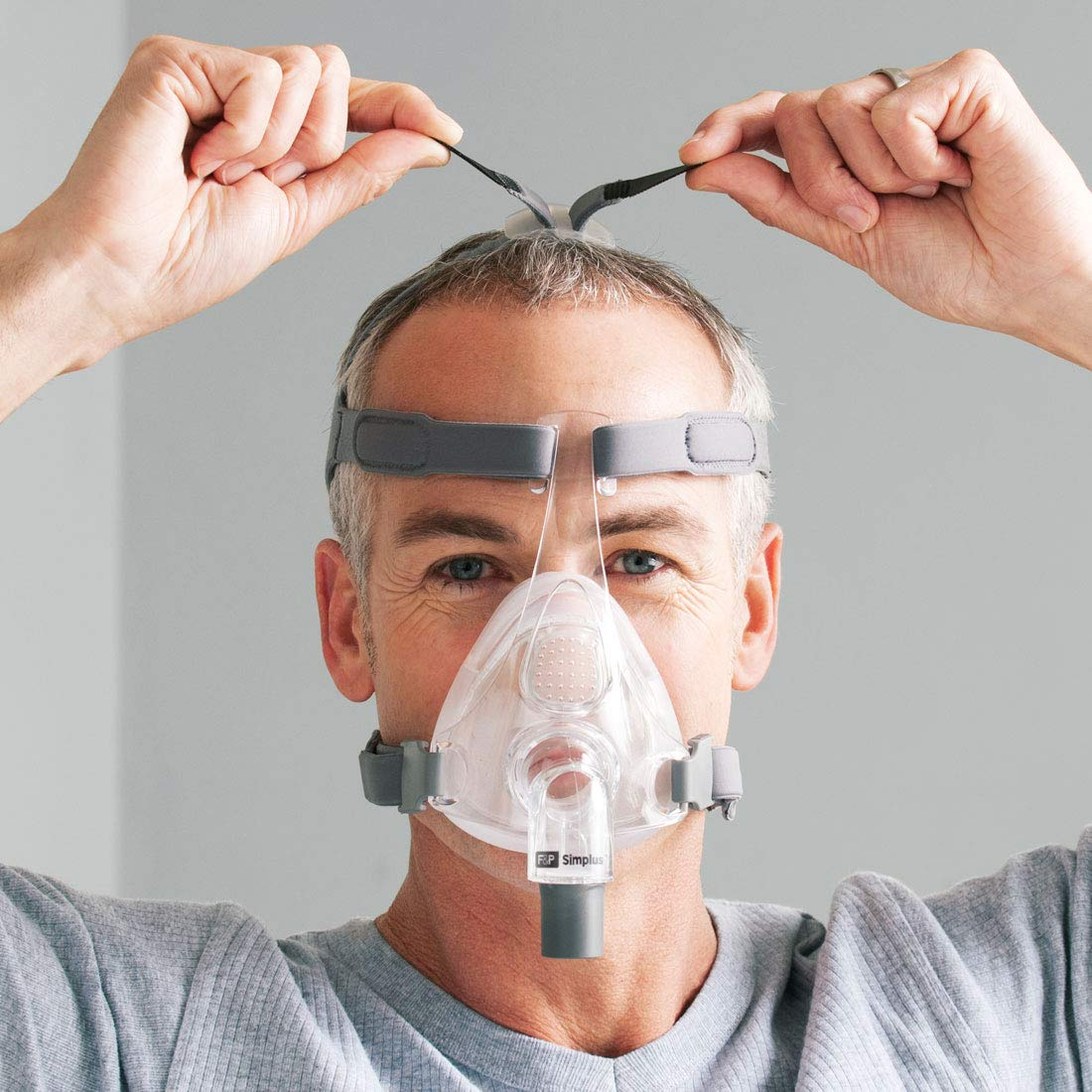 Man adjusting the headgear of Simplus Full Face Mask