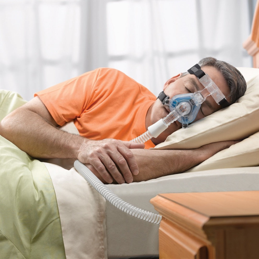 Side sleeper man with Phillips Respironics ComfortGel Blue Nasal Mask.