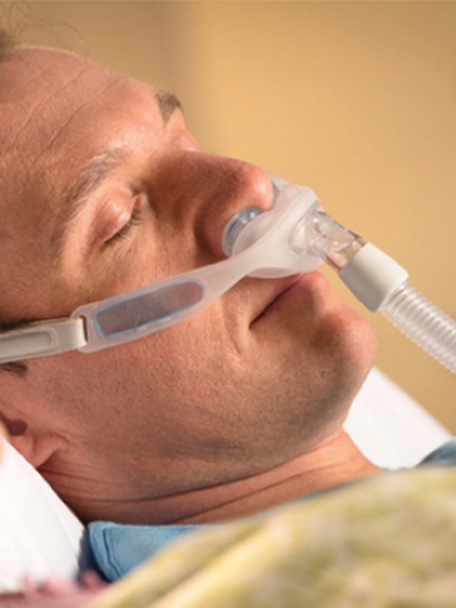 Man sleeping with Respironics Nuance Nasal Mask.