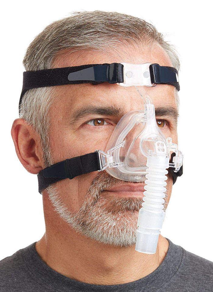 Adult man using the Nasal Fit Deluxe EZ Mask with black Headgear by Drive.