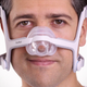 Man adjusting headgear of AirFit N20 Mask