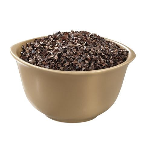 View of eco-friendly buckwheat hulls inside a golden bowl.